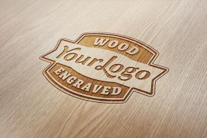 Wood Engraved Logo Mock-Up by GraphicBurger