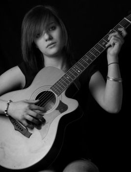 A teenager with guitar by jeanette2010
