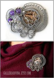 Industrial wire wrapped brooch with amethysts by Faeriedivine