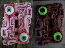 Glow in the dark eyes and tentacles switch plate by dogzillalives