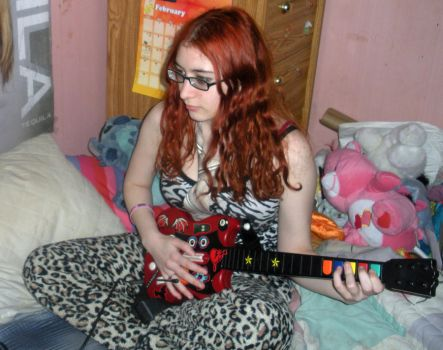 Playing Guitar Hero by Tainted-Kayla