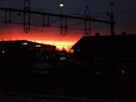 Sunset by the trainstation by Mlie-Redfield