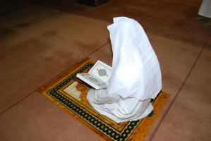 Praying The Holy Quran by billax