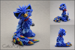 Akki the Peacock Griffin - polymer clay by CalicoGriffin