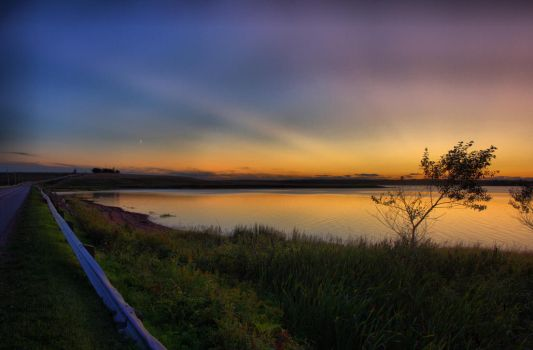 Sunset over the water by SpencerCameron