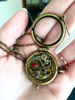 Orrery Steampunk Locket  by Ristay