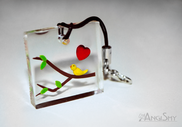 Resin pendant - bird on a branch by Angi-Shy