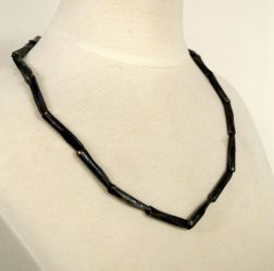 Steel necklace with brass rivets by TheAluminumSurfer