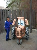 I befriend the cow tractor at Mater's Petting Zoo by Magic-Kristina-KW