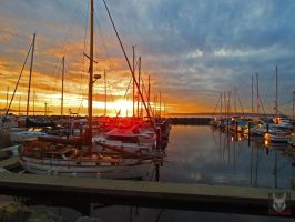 Sailboats In A Row Sunset by wolfwings1