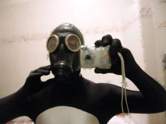 Punisher with gasmask+rubber hood 1 by rubbermask