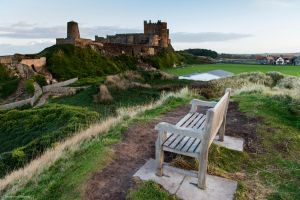 Bamburgh bench on a hill by LordLJCornellPhotos