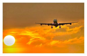 Airplane in sunset by Mantoius