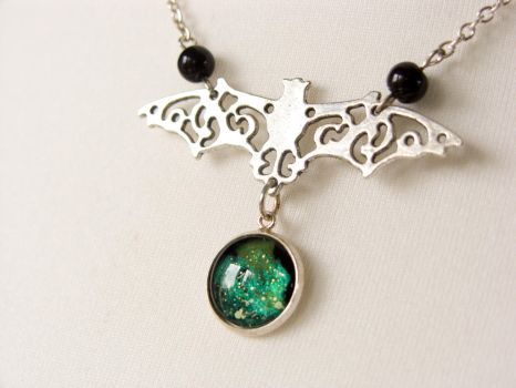 Bat necklace with hand painted glass galaxy by OkeMani