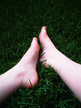 Feet in the grass by unlikemonday