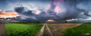 Storm covered sunset by NorbertKocsis