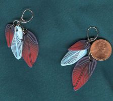 Feather earrings by Glori305