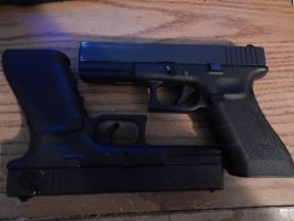 Glock 17 and 18C by Wolf999679