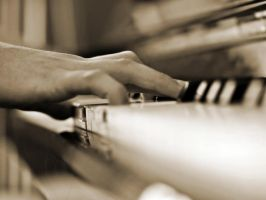 Touching the piano key by NickKoutoulas