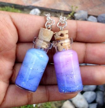 Blue an purple Nebula necklaces by Saloscraftshop