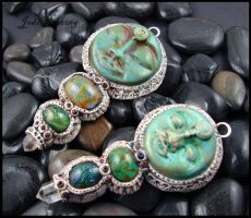 Clay - Glass - Leather Goddess Pendants by andromeda