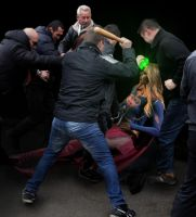 Supergirl is beaten by the mob by Tormentor-X