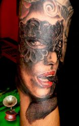 Masked lady tattoo by loop1974