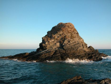 big rock at sea by welder-stock