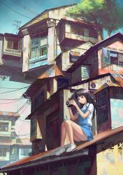 Girl with camera on rooftop by FeiGiap