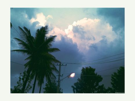 Light bulb and storm clouds by Swaroop