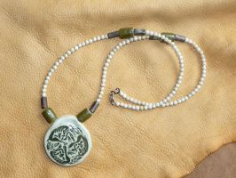 Celtic knotwork canines necklace by lupagreenwolf