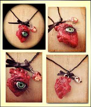 Anatomical Heart necklace (with eye) by blackkitty84