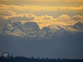 Golden Snowey Mountains by wolfwings1