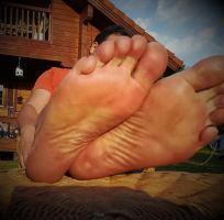 relaxing my feet in the evening sun 2 by Netsrot1971