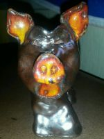 a pig made out of clay (front side) by Schrucy