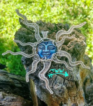 Rainbow Hematite Wire Wrapped Sun Pendant by TsalagiWireWorks