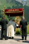 Priest with Blessed Sacrament by steppeland