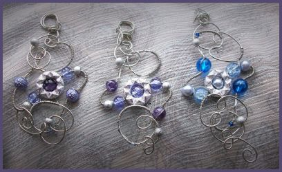 Galaxies Wire Wrapped Pendants by balthasarcraft