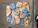 Wood faces with spray paint and paint markers by Thehuntedartist