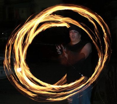 Hubby spinning fire Poi by AriannaSage