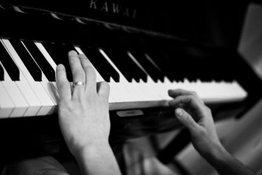 My brother playing the piano by eb-razer