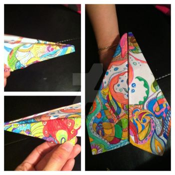 the process of making a paper airplane by SukieLuv